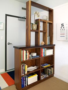 such a simple practical and stylish solution for a common problem .... the entry door that opens directly into your living space.  This could be purchased, custom made, or a combination.