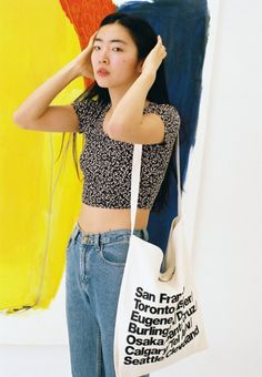 Yuri wears the Nathalie Du Pasquier Black Winie Print Crop T-Shirt with classic denim.