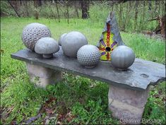 Make Cement balls by pouring cement into glass globes and breaking later! Love this idea!
