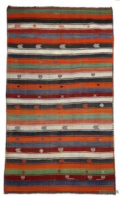 Vintage Turkish kilim rug handwoven in 1960's in Sivas in Central Anatolia. This striped kilim is in very good condition.