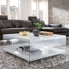 • Stylish 2 tier design rectangular glass coffee table • Contemporary styling and quality design • High strength tempered glass used for piece of mind • With extra space for sto...