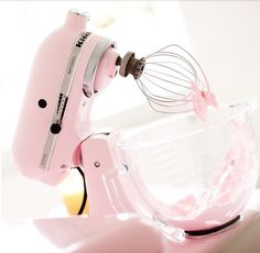 I have a pink mixer! Wish I had glass bowls with it. I can never get the metal shiny and streak free!