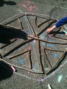 Creating shapes out of sticks: the only materials needed are sticks-- sidewalk chalk is optional!