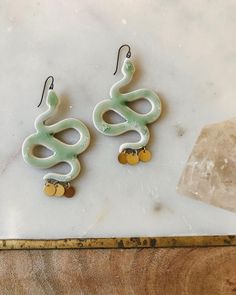 Looking to ssssshhhake things up during your holiday celebrations 🎄 this year? Then look no further than these handmade porcelain sea-foam green snake earrings 🐍. These handmade earrings are the perfect aesthetic all year round.