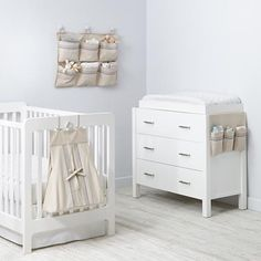 Hushaby Nursery Storage Collection (Neutral) - his organic cotton collection features everything you'd need for your nursery. The diaper holder, Changer Runner and Wall Hanger feature organic yarn embroidery and tons of storage.