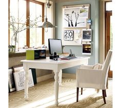 linen pin board from Pottery Barn, love the slip covered arm chair + white table