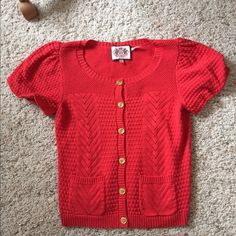 Juicy Couture Short Sleeve Sweater No rips or stains. This item is in good condition but it has been worn. Please ask any questions before purchasing. Offers submitted in comments will be ignored Juicy Couture Sweaters