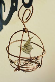 "For Medford Medford O'Keefe A more ""rustic"" idea for hanging around the garden. Pretty Ditty: Bird and birdcage ornament tutorial Wire Crafts, Fun Crafts, Arts And Crafts, Paper Crafts, Diy Paper, Christmas Ornaments To Make, Christmas Crafts, Paper Ornaments, Christmas Tree"