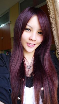 Omg.........i want her hair color!!! standard dark red/violet hair
