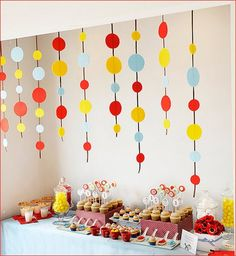 Felt circle streamers  Event Company: {Real Party} Curious George Birthday Party
