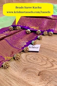 Beads Saree Kuchu designs are exclusively handcrafted to complement your sarees for once in a life time events. Krishne's designer tassel kuchus are crafted using a combination of handcraft techniques like Aari, Crochet, Hand Embroidery, Zardozi etc and are in the price range of ₹ 500 ~ 5000. Click www.krishnetassels.com/tassels to see all the kuchu types, price range & information to place your order.. Saree Tassels Designs, Saree Kuchu Designs, Wedding Saree Blouse Designs, Silk Saree Blouse Designs, Saree Blouse Patterns, Embroidery Dress, Hand Embroidery, Embroidery Designs, Black Saree Blouse