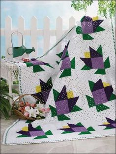 "Tulip Garden Afghan - These geometrical tulips will make an attractive addition to your home.  Size: 58""x78"".  Skill Level: Beginner Designed by Martha Brooks Stein free pdf"