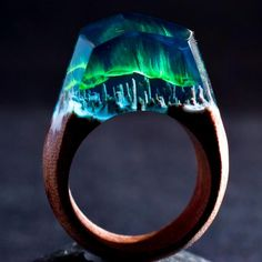 Aurora Borealis Magic in the skies to amaze the eyes. Bright northern lights bring endless delights. This ring is made of grey blue resin with green auroras. Th