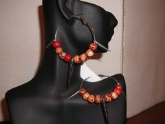"""Wooden Beads/w Spikes: 2"""" Inch Earrings $6.00 (+ Shipping $3.50) to Purchase item please email Leonie at leonie@rsgiftsandfashions.com. You will receive an email response within 24hours. All payments are made through paypal.( Order 4 or more pair Free Shipping!). www.rsgiftsandfashions.com"""