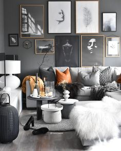 Stylish living room done in a monochromatic way that allows the accent colour to really pop. Well-executed.