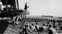 An army chaplain conducts a service from the cockpit of an aeroplane