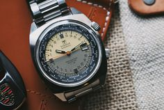 Vintage Tissot T12 Navigator Seastar World Time. Rare example of 24-hour automatic military watch. Available sometimes under $1K.