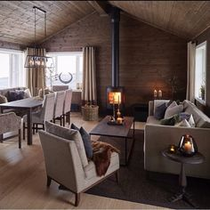 Loving the wood stove warming the dining and living spaces. Seems more conducive to affordable living. Interior Stairs, Interior Exterior, Log Cabin Homes, Cabin Interiors, Cozy House, Home Furniture, Living Spaces, Sweet Home, House Design