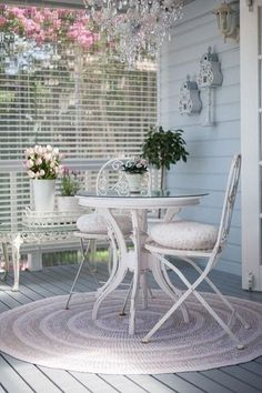 Beautiful shabby chic balcony. Refresh your garden or balcony in the spring with the warm and comfortable shabby chic style! Vintage pastel colors, delicate round rug, the crystal chandelier...All looks so bright, cozy and inviting!