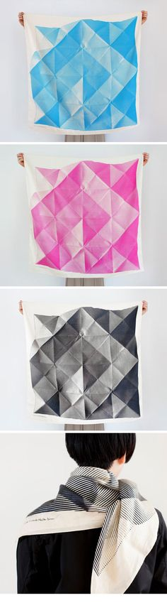 "Collaborating designer Lucinda Newton-Dunn describes her artwork for these unique furoshiki: ""This design is based on the Japanese tradition of origami. Continuing with the theme of folding and wrapping, this design depicts a folded piece of paper, exploring three-dimensionality through line and pattern. At first glance, a quarter of folded furoshiki appears to be decorated with nothing more than bold stripes, but viewed as a whole it transforms into an intricate trompe l'oeil."""