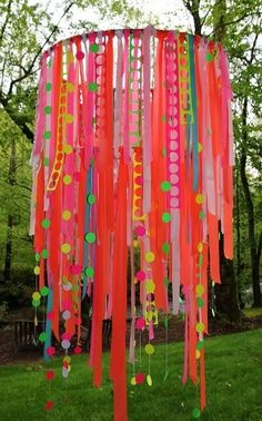DIY- Party Chandelier- This lady makes a festive party decoration with some hula hoops, ribbon and other cool trinkets! It would be a fun decoration in a little girls room too! Would also be great with crepe paper streamers.