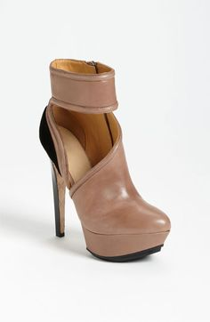 If you work in a stylish place, these will totally fly.  The ankle strap actually gives some support too. For a more conservative office, no one but you will know what you're rocking under your wide-legged slacks ;) L.A.M.B. 'Dotty' Pump | Nordstrom @395