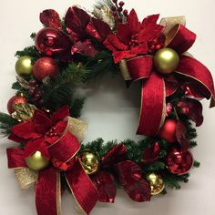 Square Christmas picture wreath in traditional colours of red and gold.