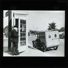 . .I HOPE YOU'LL FOLLOW ANY OF MY 5 GREAT BOARDS CONCERNING THE POST OFFICE MAILMEN VEHICLES MAILBOXES AND OTHER THINGSPostman Entering Telephone Kiosk 1934