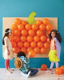 Balloon Game from Martha Stewart! Ideas are endless: use different color balloons to make different shapes, letters or numbers (like a red apple, or a number for a birthday party) or just make a random rainbow wall of balloons. Fill balloons with confetti, stickers, or candy so kids can pop them to get the surprise inside. You can also hang the balloons on a string for more of a pinata style game!