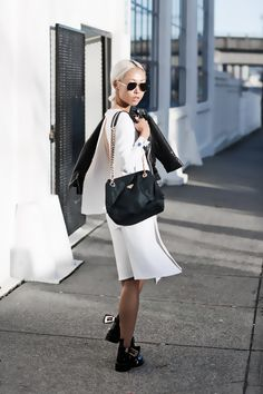 Street Style December 2014: Vanessa Hong is wearing a vintage biker jacket, white silk blouse from TFC, matching skirt and the boots are from Balenciaga