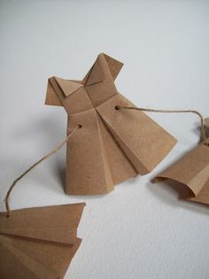Plain Janes: Paper Dress / Origami Dress Garland / Minimalist / Brown by scrappymade on Etsy https://www.etsy.com/listing/226222695/plain-janes-paper-dress-origami-dress