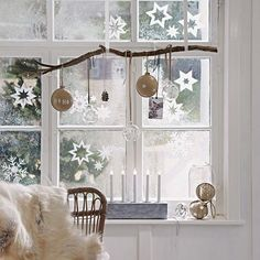 hang a branch and ornaments of various kinds on it, and add paper snowflakes