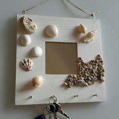 Key holder=ikea mirror, sea stuff