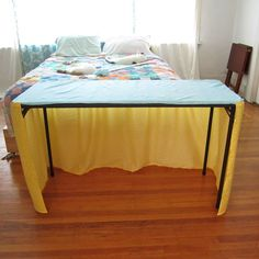 Handmade fabric tablecloth - gathered and open in the back for easy access to stored items