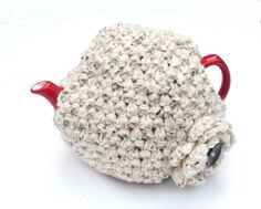 Aran Tea Cosy  cream hand knitted wool tea pot by TheFeminineTouch, £24.00  Maybe I have to add Cozy to my description for my board? AH