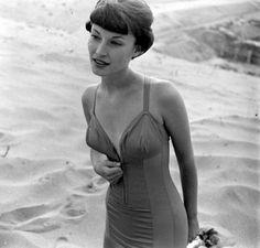 Model wearing a zip-up swimsuit, 1950s.
