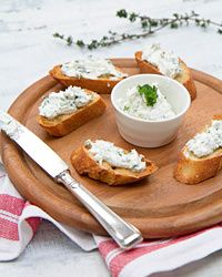 Goat Cheese-Garlic Toasts Recipe on Food & Wine. I think these would be fantastic with a tomato salad!