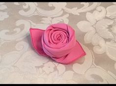 I demonstrate how to fold a cloth napkin into the shape of a rose bud. My mom has a friend named Bobbi. Bobbi has a friend who taught us how to make these napkin roses. Link to How to Fold a Napkin into a Christmas Tree video:  ... . How, Rose, Fold,