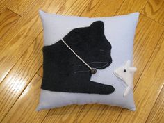 Whimsical and sweet pillow featuring a sleeping black kitty cat and a curious little white mouse peeking at him. This pair looks very realistic. Ive used plush material to make them soft and furry. The mouses one ear sticks off the pillow, he has a black bead eye and grey whiskers. The