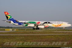 """South African Airways Airbus in the """"Olympics"""" livery (registered ZS-SXD) Franz Josef Strauss, Airplane Design, Aircraft Painting, Commercial Aircraft, Aircraft Pictures, Aeroplanes, Concorde, Paint Schemes, Vintage Posters"""