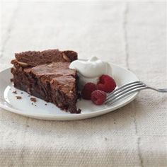 Made this Chocolate Almond Torte from @McCormick Spice for a dinner party tonight, complete with a chocolate drizzle, fresh raspberries and homemade vanilla-almond whipped cream. @Rebecca Helmke thought of you while flavoring with almond extract!