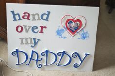 Military deployment homecoming sign idea using puff letters and wooden pre-cut letters that were painted with glue and covered in glitter.
