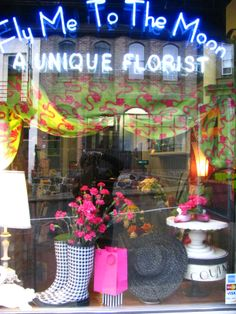 Mother's Day window of Fly Me To The Moon Florists #flymetothemoonflorists #storefront #flowershop