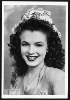 A 15-year-old Norma Jeane poses in 1941. She is one year away from her first marriage and five years away from breaking into movies and changing her name to Marilyn Monroe.