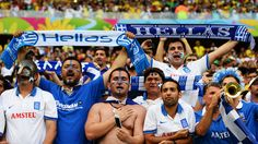 The Greece fans show their support ahead of their game with Ivory Coast.