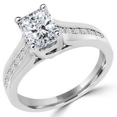 MD140094    No jewelry box would be complete without this stunning engagement ring featuring a radiant cut diamond with white accent diamonds,