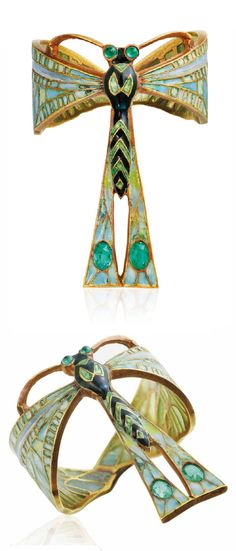 LUCIEN GAILLARD - AN ART NOUVEAU ENAMEL AND EMERALD RING, CIRCA 1900. Modelled as a naturalistic dragonfly, set throughout with multicoloured window enamel, with emerald details, mounted in gold, signed L. Gaillard.