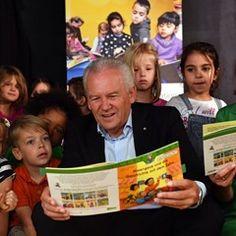 Ruediger Grube and Christina Rau read stories to children in Potsdam