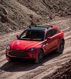 After introducing their first motorcycle, Iconic British car maker Aston Martin have now presented their first-ever SUV, the all-new DBX! After several spy shots and teasers over the past year, Aston Martin´s long-awaited SUV has finally been r Best Suv Cars, Alfa Cars, Large Suv, Aston Martin Lagonda, Triumph Scrambler, Luxury Suv, Twin Turbo, Amazing Cars, Dream Cars