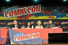Kit Harington Photos Photos - (L-R) Samuel Hadida, Kit Harington, Adelaide Clemens and Michael J. Bassett attend the 2012 New York Comic Con at the Javits Center on October 12, 2012 in New York City. - 2012 New York Comic Con - Day 2